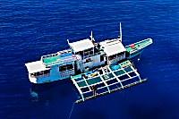 große Banca (Auslegerboot) des Dugong Dive Centers