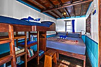Deluxe Kabine mit einem Doppelbett und zusätzlichem Hochbett