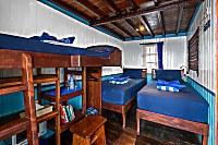 Deluxe Kabine mit zwei Einzelbetten und zusätzlichem Hochbett