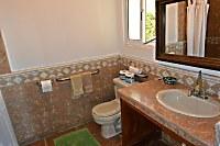 Badezimmer in einem Deluxe-Bungalow
